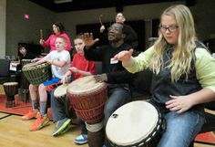 Crossroads students Chance Mingus, Nathan Hampton and Meah Burroughs are joined by Hamidou Koivogui, Gregory Acker, a local West African Drum and Dance expert, music teacher Amy Cuenca and physical education teacher Nickie Spencer.