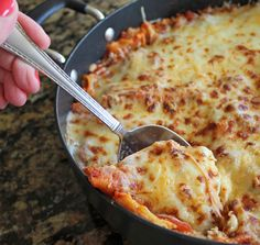 30 Minute Skillet Lasagna ~ A flavorful meat sauce is layered between delicious lasagna noodles and a fabulous cheesy mixture. All of these layers are placed into a skillet right on your stove top. The noodles cook right in the sauce!