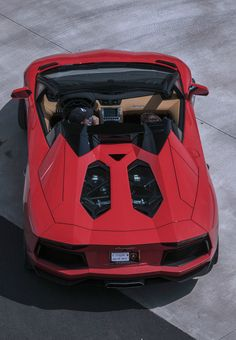 Smoking hot red Lamborghini Aventador Roadster up for grabs this #SupercarSunday #spon