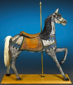 C.W. Dare Carousel Horse, ca. 1880. This extremely rare and enchanting carousel horse by Charles W. Dare is a highly important piece of antique Americana. One of the earliest works by one of the first carousel makers in the United States, this remarkable horse exudes an undeniable charm.