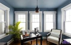 HGTVs Cousins Under Cover- A room with ample natural light is a perfect spot to try out a bold color on the walls and the ceiling. This home office is beautiful in a saturated blue thats balanced by the windows and the crisp white trim, as seen on HGTVs Cousins Undercover.