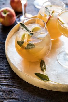 Kicking off the Thanksgiving cocktails with this Harvest Apple Ginger Spritz. Fresh apple juice combined with vodka, orange liquor, and lemo # Thanksgiving Punch, Thanksgiving Cocktails, Fall Cocktails, Thanksgiving Recipes, Fall Recipes, Craft Cocktails, Apple Cocktails, Halloween Cocktails, Winter Drinks