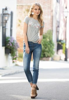 Style Greetings   Say hello to charming street style in our soft graphic tee and dotted skinny ankle jeans. Add wrap ankle strap heels, disc dangle statement earrings and a layered tassel necklace to create a welcoming look.