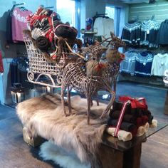 Our Nordic Store reindeers carrying a sled full of beautiful Icelandic wool blankets. :)