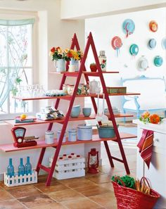 Marie Claire Idées - Ladder with shelves for display. This is a retail display, but, with removable shelves, it could be portable enough to work for craft shows too. Would make a great plant shelf, too! DIY