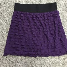 Express mini skirt ⭐️final price ⭐️Express tiered mini skirt in dark purple. Size medium. Comfortable elastic waistband. Gently used. One snag that I can see. pictured above its on the side so not noticeable. Really cute with leggings and boots in the wintertime. Or a tank in the summer. 17 inches to hem. Clean smoke free home. Express Skirts Mini