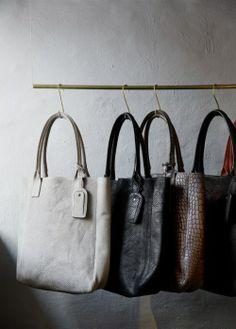 Hanging Handbags at Yvonne Koné Pop-up Shop, via lagraphicdesign.wordpress.com