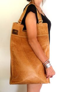 Mi Vida bag from Elf leather -- folds down to a smaller satchel and has an inner zip compartment and two pocekts.