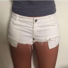 White Brandy Melville Shorts This denim cut off shorts from Brandy Melville is worn, but in great condition!! its distressed and perfect for the beach, hanging out with friends, etc. this short-short is a European size 42, but in the US it's approximately a size 8. can fit a natural size 4-8 Brandy Melville Jeans