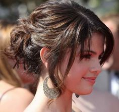 Selena Gomez has a celebrity updo which will also go well as a bridesmaid hairstyle.