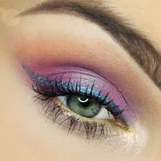 This whimsical eye makeup features a vibrant lavender eye shadow with gold and blue shimmer accent to complete the look. Check out the products used to achieve this stunner. Beauty Nails, Beauty Makeup, Hair Makeup, Sunset Makeup, Eyeliner, Eyeshadow, Glitter Liner, Evening Makeup, Rainbow Hair