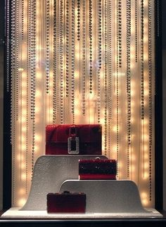 Leiber depicted snow in action inside its six windows along Madison Avenue. Textured upholstery fabric and silk covered the product base and risers, while ball and chain links in various lengths and gauges hung from the ceiling. Twinkling lights simulated the feeling of snow falling. (Photo: Jonathan Ro-Schofield, New York)View Image Details