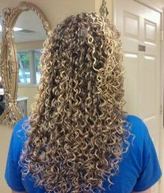 lots of curl in this long perm style