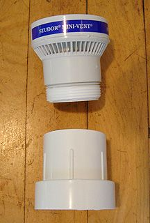 Air admittance valve, for venting branch lines in residential plumbing drain systems.
