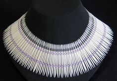 """Neckpiece:  """"Don't Pick On Me""""  (Plastic Dental Picks, Linen Thread - designed and created by Karen J Lauseng).  An image of this piece appeared in Art Jewelry Magazine as well as Dear Doctor Dentistry Magazine."""