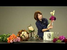 Design Director Loann Burke, AIFD, PFCI, discusses the benefits of designing a bouquet holder, even for hand-tied bouquet looks, to keep flowers fresh throughout the long day.