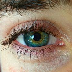 his eyes were greeny blue like the sea