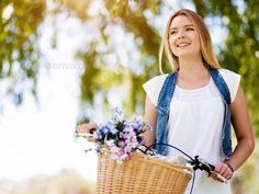 Happy young woman with bicycle by nexusplexus. Price $5