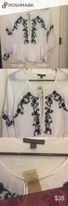 American Eagle ruffle top NWT New with original tags. Size M, true to size. White with navy blue designs on the front/sleeves. Made out of 100% viscose. 3/4 sleeves. American Eagle Outfitters Tops