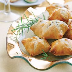 Mini Beef Wellingtons Recipe Appetizers, Main Dishes with extra-virgin olive oil, crimini mushrooms, fresh rosemary, ground black pepper, sea salt, large eggs, pastry dough, beef tenderloin, Boursin