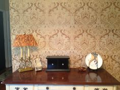 A stenciled accent wall using the Anna Damask Allover stencil pattern from Cutting Edge Stencils. http://www.cuttingedgestencils.com/damask-stencil.html