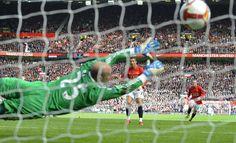 Cristiano Ronaldo blasts the ball past Pepe Reina - Tom Jenkins (Guardian / Observer)