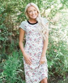 **New Dress Arrival** The Reagan Pink Floral Striped Dress is sure to be a Summer favorite! Shop now by clicking on the picture and receive FREE shipping!! || Bella Ella Boutique