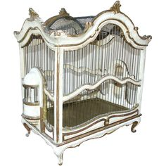 Antique Italian birdcage with carved wood body and gilt decoration and painted surfaces.