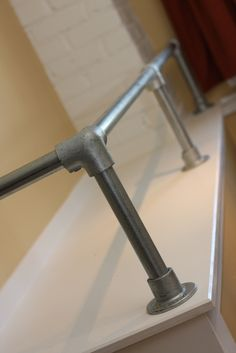 Railing Idea                              Who says that pipe handrail only belongs outdoors?! Those are fightin words! OK, OK Im not that passionate about the subject, but pipe railing can make a really great alternative to standard indoor stair handrail. I thought so, and thats why I used it in my new office. Pipe handrail can create a really great industrial accent to a space. In my case it also fills a very functional role.