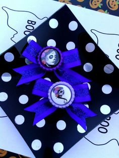 New listing in my etsy shop. $7.50 for set of purple day of the dead bottlecap hairbows. Etsy.com/shop/bowsnicecream