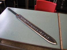 "Runeblade from 2007 Made of differential-hardened springsteel, of which the unpolished length of the blade is oilscorched and engraved, with a reindeer leather-wrapped handle. The ""text"" is a botch. Swords And Daggers, Knives And Swords, Katana, Armadura Cosplay, Armas Ninja, Cool Swords, Ninja Weapons, Sword Design, Weapon Concept Art"