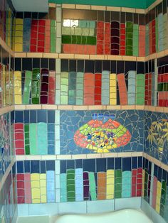 Detail of the bathroom Library Mosaic. The three walls are covered with mosaic books, made from discarded kitchen tiles Mosaic Art, Mosaic Glass, Mosaic Tiles, Mosaic Books, Stained Glass, This Is A Book, I Love Books, Book Art, Mosaic Bathroom