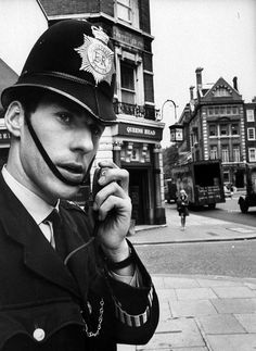 The people, places, and experiences of Scotland Yard-- London's police service-- in A policeman uses a two-way radio. Police Uniforms, Police Officer, Sirens, Radios, Police Dispatcher, London Police, Manchester Police, 19th Century London, Acid House