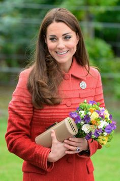 The Duchess wore a coral and red striped coat by Scottish designer Jonathan Saunders and a dress by Goat.