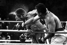 Oct. 30, 1974,  file photo showing George Foreman taking a right to the head from challenger Muhammad Ali in the seventh round in the match dubbed Rumble in the Jungle in Kinshasa, Zaire. Ali, the magnificent heavyweight champion whose fast fists and irrepressible personality transcended sports and captivated the world, has died according to a statement released by his family Friday, June 3, 2016. He was 74. (AP Photo/Ed Kolenovsky, File)