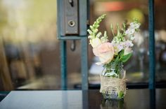 i enjoy the longer-stemmed flowers behind the rose to be used as filler-ish flower in dining centerpieces if they are more practical in late May than the others mentioned on this board