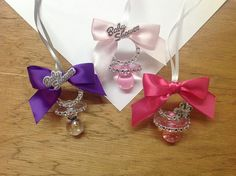 here's another one 12 pcs Baby Shower Pacifier Necklace It's a girl by AVAandCOMPANY, $24.99