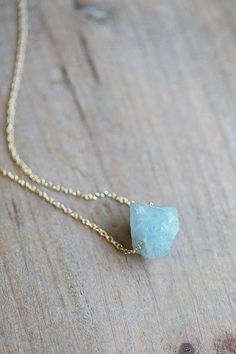 A raw ice-blue aquamarine crystal has been strung directly on to a fine precious metal chain, a stunning one of a kind piece. Each stone measures