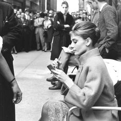 Audrey Hepburn photographed on the location of Breakfast at Tiffany's, New York City, in 1960