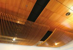 Curved wood baffle ceiling system (Architectural Components Group, Inc.)