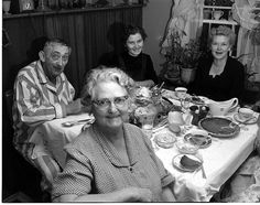 Now for the pie! - This is a wonderful old Thanksgiving photo... (Notice the lady in front and younger lady directly behind her have the same smile; mother and daughter?)