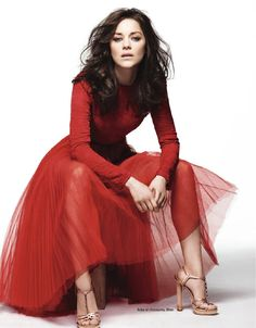 Marion Cotillard in Dior - beautiful colour on a stunning lady. Proving you don't have to show skin to be sexy
