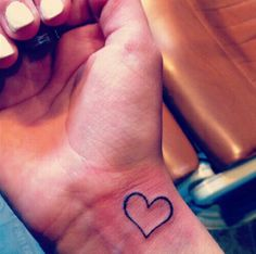 This tattoo but in pink on the left wrist on my pulse