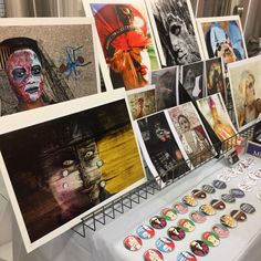 Here's my exhibit at the List Distillery in Fort Myers, Florida during Art Buzz, a one-night event with free samples of flavored liquors, live music and a select group of local artists. Our bestselling button during this event was: The World is Watching.