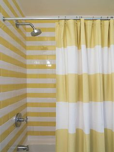 West Elm Stripe Shower Curtain + matching stripe tile!! >> Perhaps a bit too much, but still pretty and unique!