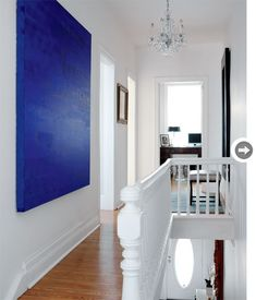 A canvas painted a single, saturated hue against crisp, white walls