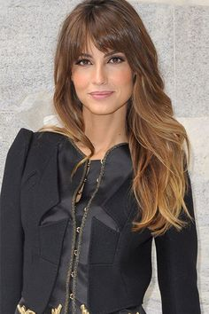 The French je ne sais quoi is never better exemplified than by short mussed-up bangs and long, tousled waves.