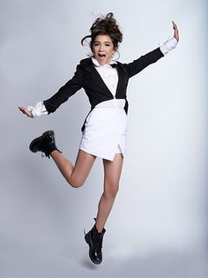 Rowan Blanchard. Mod. June 2014. Available for license through Corbis Outline. Photographer: Axel Muench. Art Director: Marla Carlton. Hair: Patrice Bisiot. Makeup Angelina Cheng. Stylist: Maro Medi. Wardrobe: Jacket and Blouse, Vintage Stella McCartney. Skort, Topshop. Shoes, Rowan's Dr. Martens.
