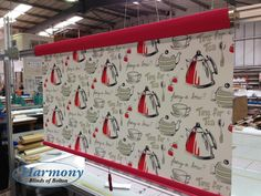 Bespoke senses roller blind design by Harmony Blinds of Bolton. Fabric: Tea for Two by with a deep red pelmet and bottom bar. Perfect Blind for a Kitchen