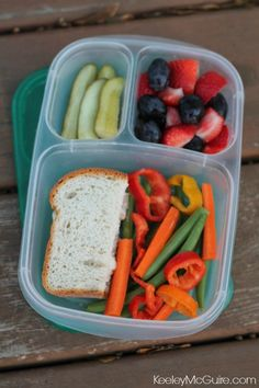 #MomFood #WorkLunch  Half a sandwich on Udi's Gluten Free bread, mixed veggies, strawberries & black grapes, & pickle spears. #EasyLunchboxes